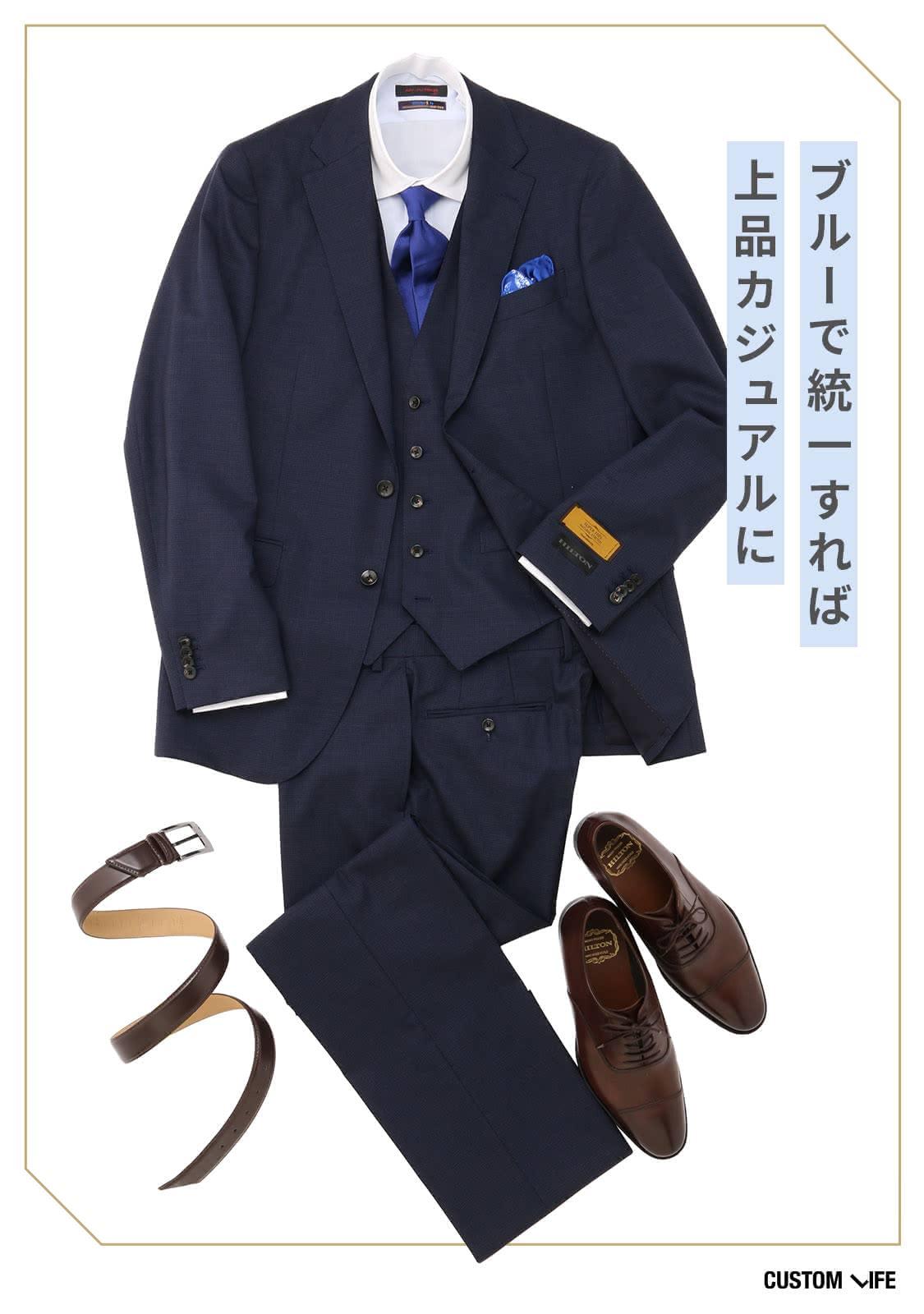 ネイビースーツにブルーのネクタイ