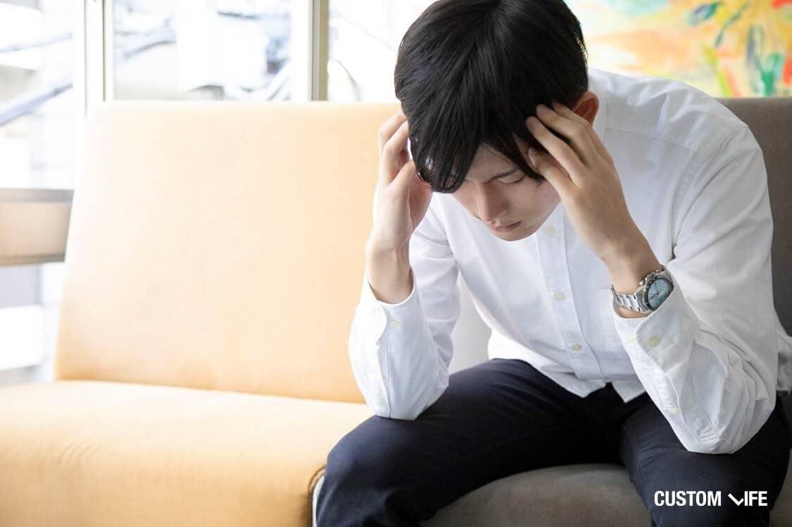 副作用に苦しむ男性
